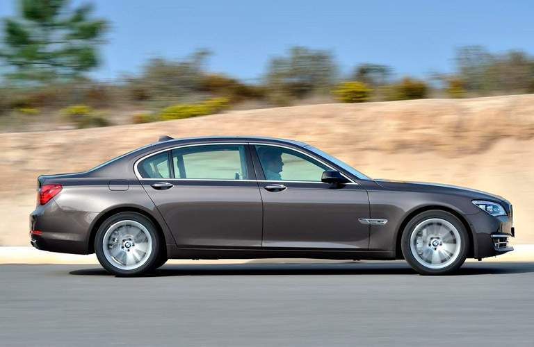 2014 BMW 7 Series driving during the day