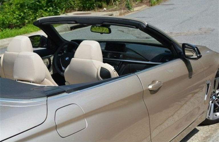 2014 BMW 4 Series 435i convertible parked in the sun