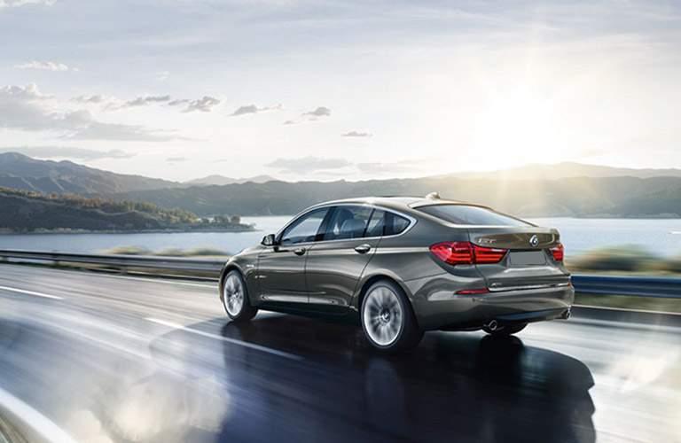 2016 BMW 5 Series sedan driving on a road