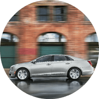2018 Cadillac XTS driving passed buildings