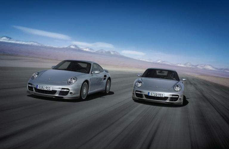 two 2009 Porsche 911 Turbo racing each other