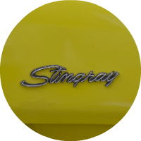 Corvette Stingray logo on yellow