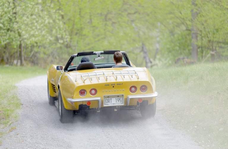 classic yellow Corvette Stingray driving away