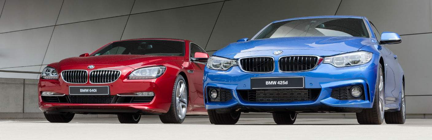 Red and Blue BMW models on display
