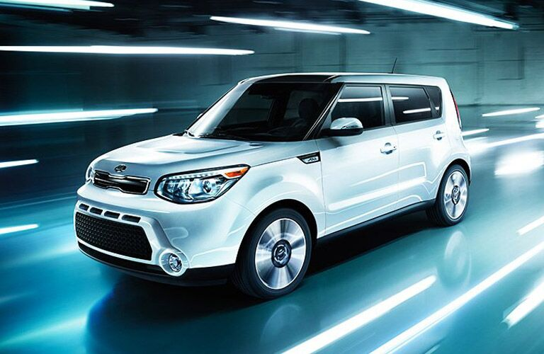 2016 Kia Soul in white driving through a dark tunnel with streaks of white light