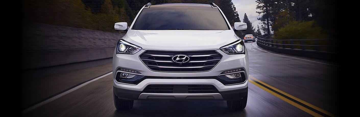 white Hyundai Santa Fe front view