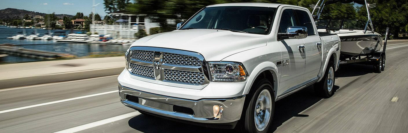 2017 RAM 1500 in white towing a speed boat