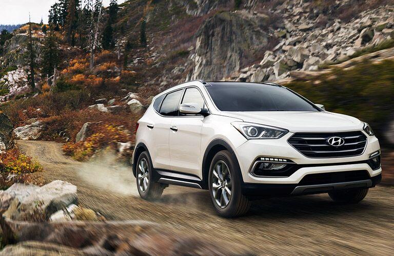 white Hyundai Santa Fe Sport front side view