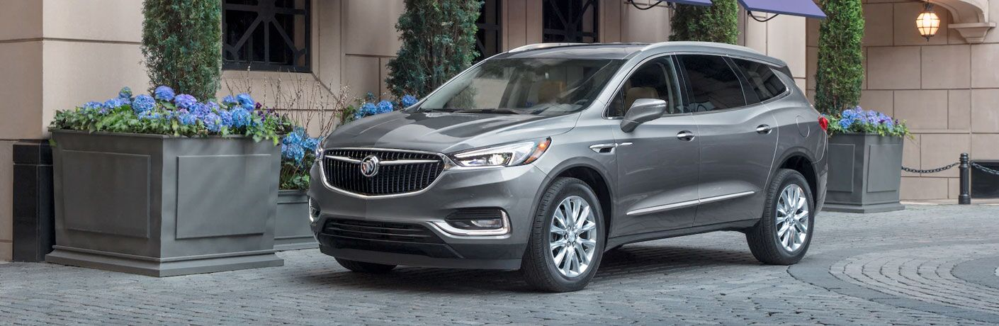 2020 Buick Enclave parked in front of brick building