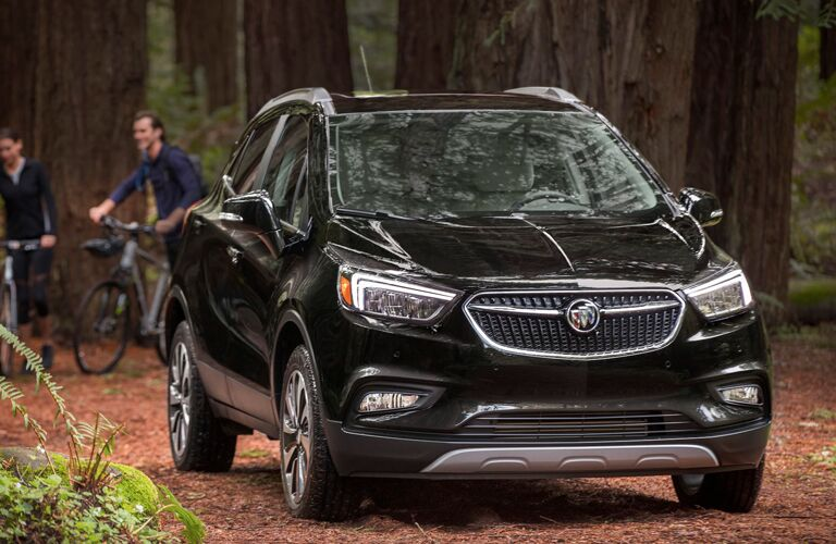2020 Buick Encore in the woods with people on their bikes