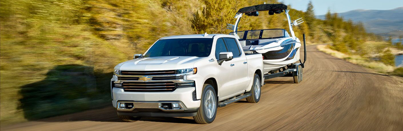 2020 Chevrolet Silverado towing a boat