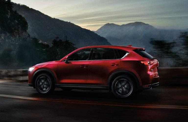 Red 2018 Mazda CX-5 Side Exterior Driving on Mountain Road at Night