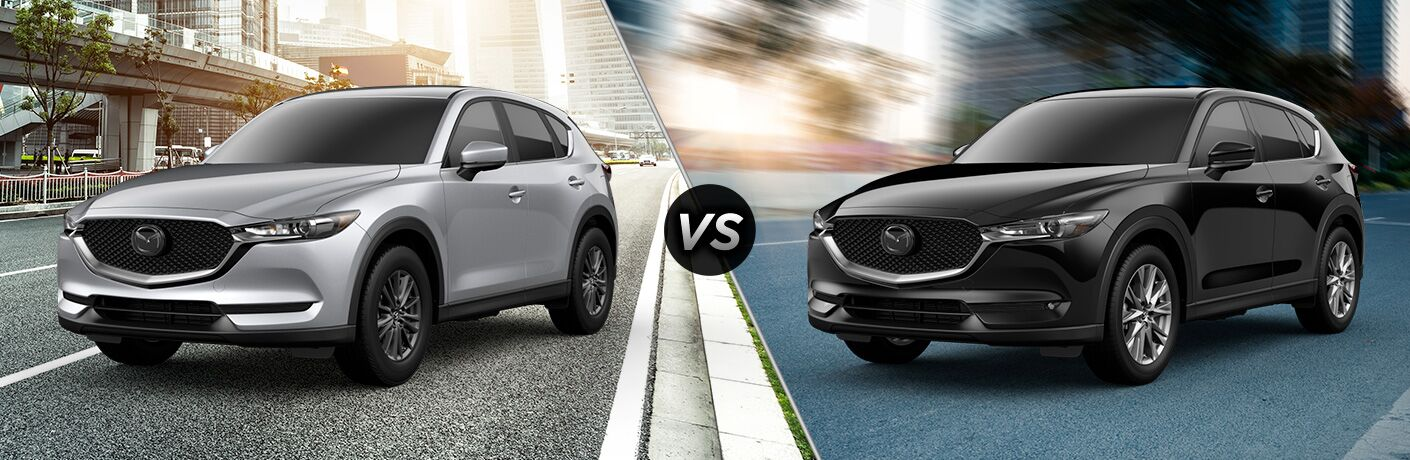 Silver 2019 Mazda CX-5 Touring on a City Street vs Black 2019 Mazda CX-5 Grand Touring on a City Street