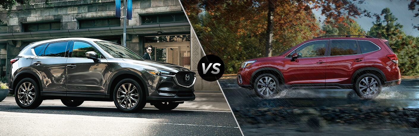 Gray 2019 Mazda CX-5 on City Street vs Red 2019 Subaru Forester on a Wet Road