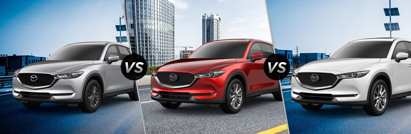 Silver 2019 Mazda CX-5 Sport on a Freeway vs Red 2019 Mazda CX-5 Grand Touring on a Freeway vs White 2019 Mazda CX-5 Signature on a Freeway