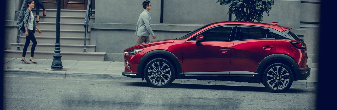 Red 2020 Mazda CX-3 Side Exterior on a City Street