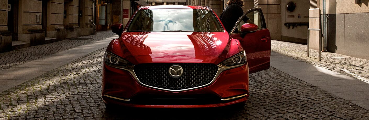 Red 2020 Mazda6 Front Exterior and Grille on a Cobblestone Road