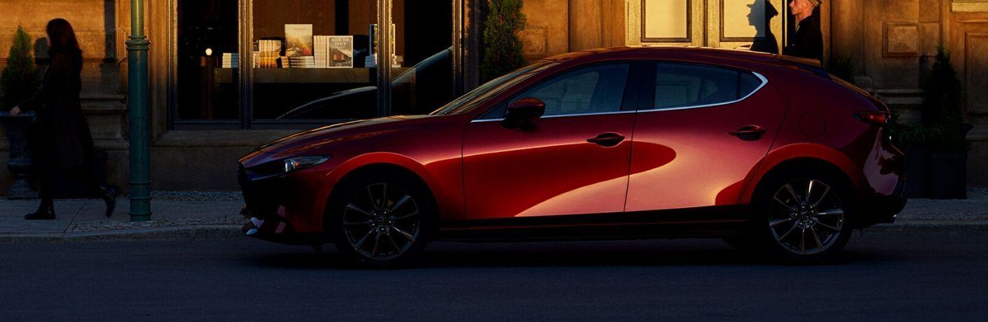 Red 2020 Mazda3 Hatchback on City Street at Sunset