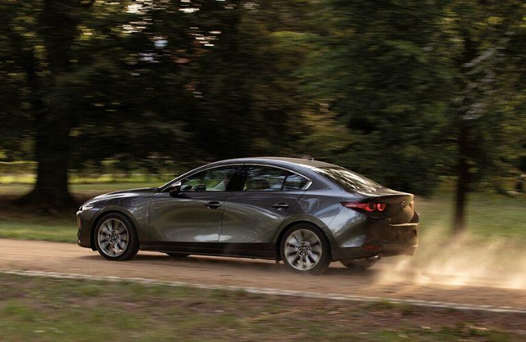 Gray 2020 Mazda3 Rear Exterior on Dirt Road