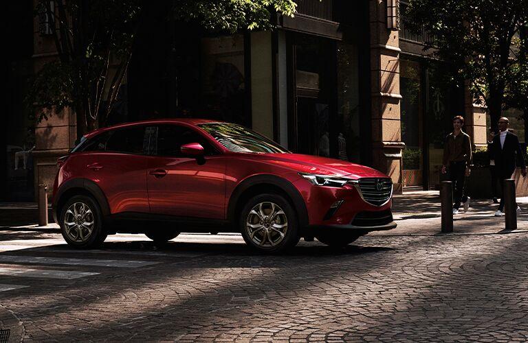 Red 2021 Mazda CX-3 on Cobblestone Street