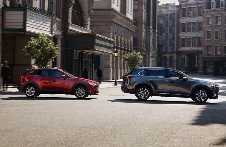 Red 2021 Mazda CX-3 and Gray 2021 Mazda CX-9 on City Street
