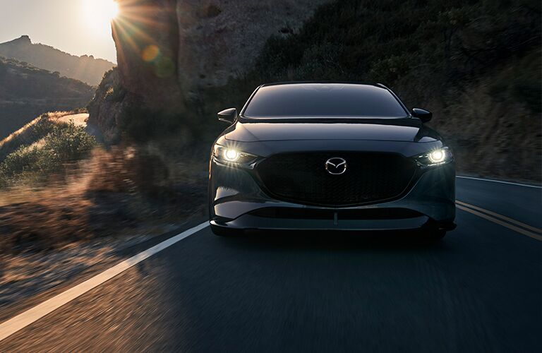 Gray 2021 Mazda3 Hatchback Front on a Mountain Highway