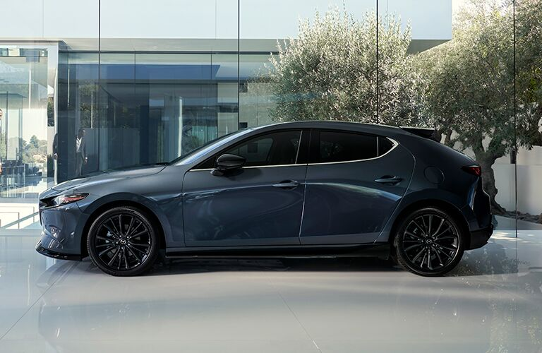 Gray 2021 Mazda3 Hatchback Side Exterior in a Driveway