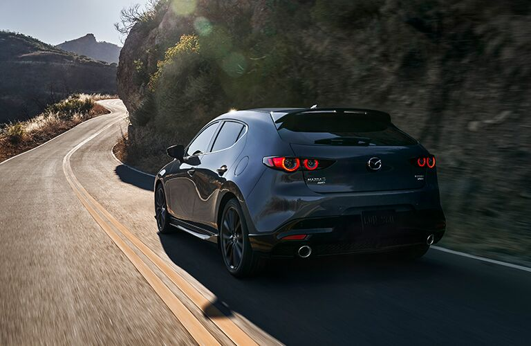 Gray 2021 Mazda3 Hatchback Rear Exterior on a Mountain Road
