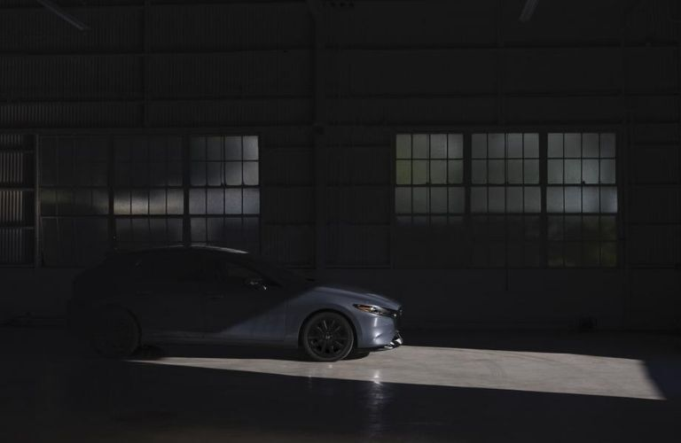 Gray 2021 Mazda3 2.5 Turbo Hatchback Side Exterior in Dark Garage