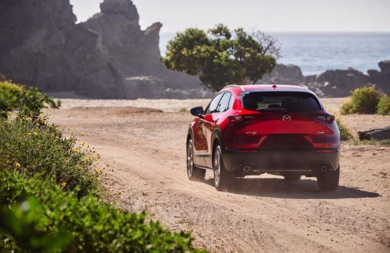Red 2021 Mazda CX-30 Rear Exterior on a Dirt Road
