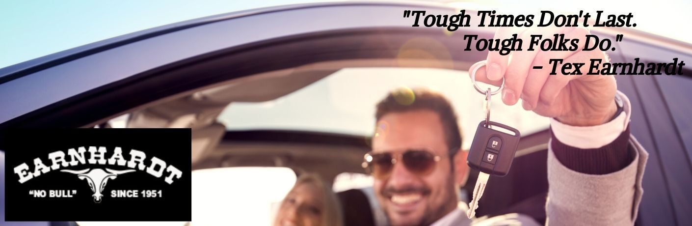 Happy Couple in a Car with Keys, Black and White Earnhardt Bull Logo and Black Tough Times Don't Last. Tough Folks Do. - Tex Earnhardt Text