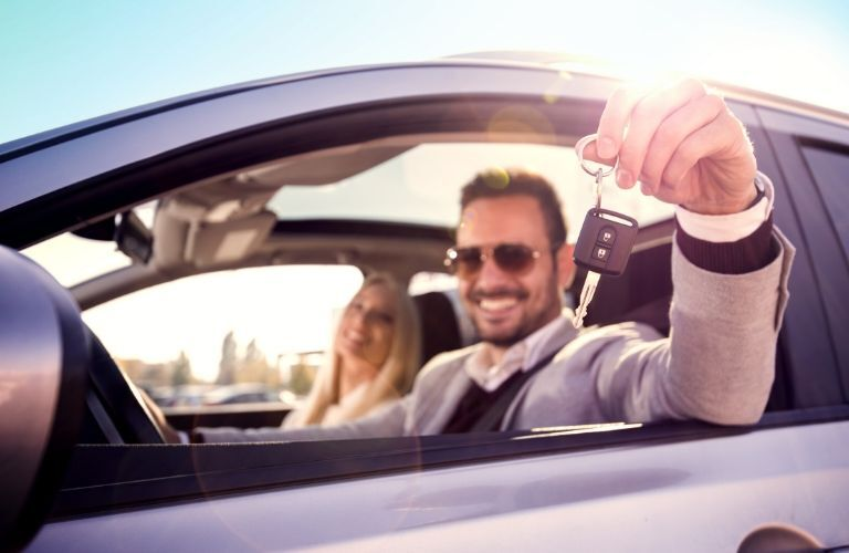 Man and Woman in New Car Holding Car Keys