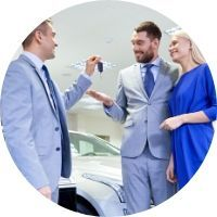 Salesman Handing Keys to a Happy Couple