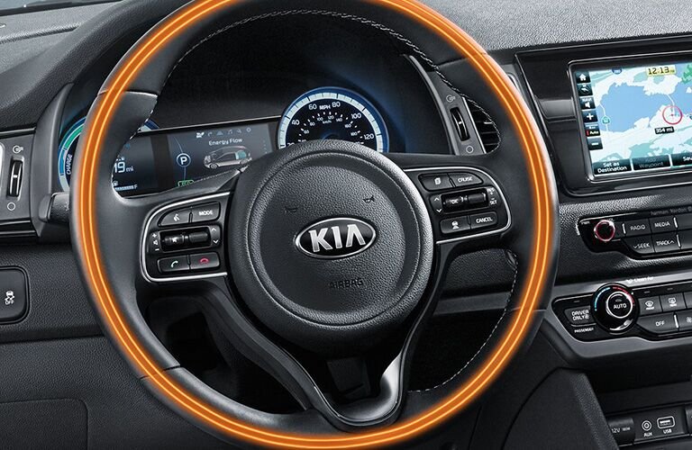 2018 Kia Niro interior close up over illuminated heated steering wheel and infotainment screen display
