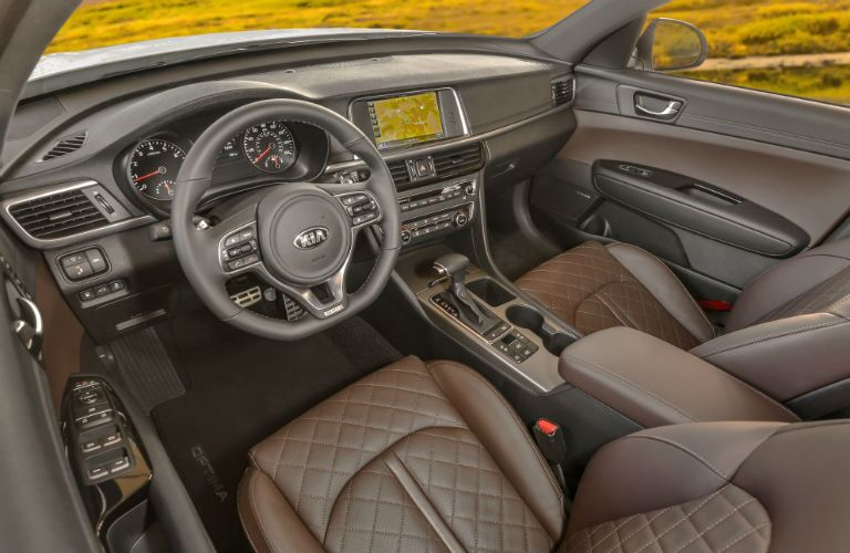 2018 Kia Optima interior above angle of front seating, steering wheel, transmission, and dashboard