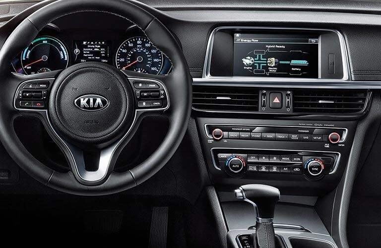 2018 Kia Optima Plug-In Hybrid interior shot of steering wheel, dashboard infotainment, and transmission clutch