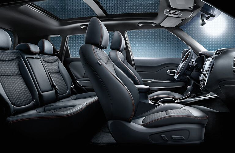 2018 Kia Soul interior side shot view of 2-row seating cabin and upholstery material