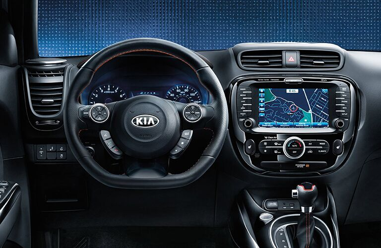 2018 Kia Soul interior front driver's seat view of steering wheel, dashboard, transmission, and navigation touchscreen