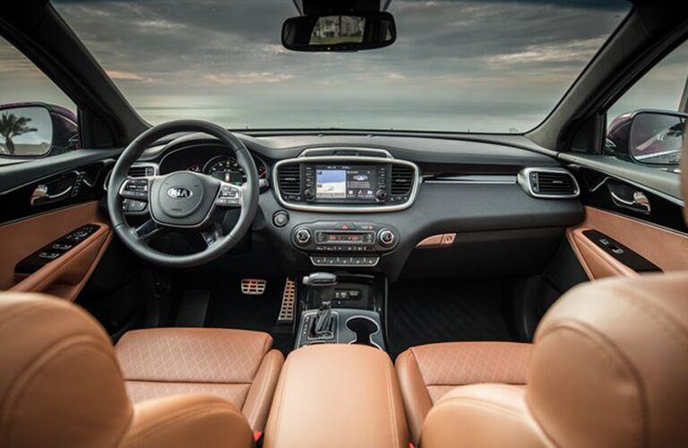 2019 Kia Sorento interior shot of front seating, dashboard, steering wheel, transmission, and monitor