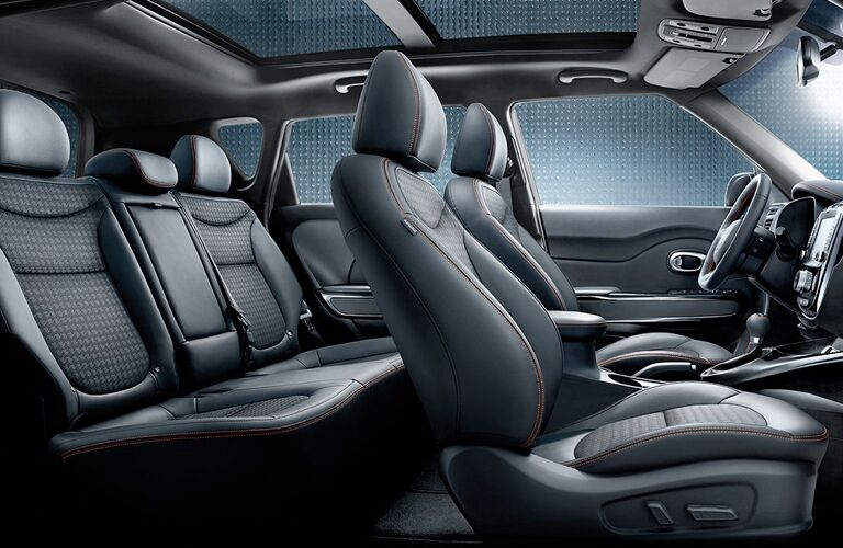 2019 Kia Soul interior side shot of seating upholstery, cabin space, and sunroof