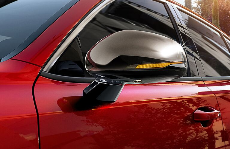 2019 Kia Stinger with red paint color exterior shot close up of side mirror with led lighting