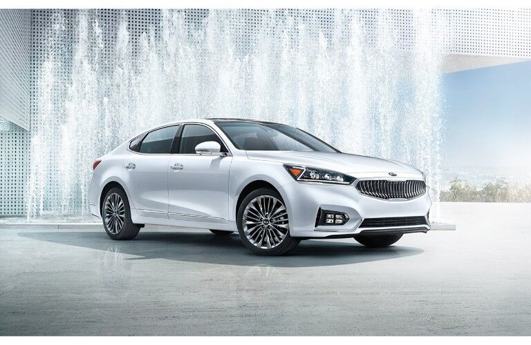 2019 Kia Cadenza exterior shot parked in front of a a bunch of jets creating a water stream fountain