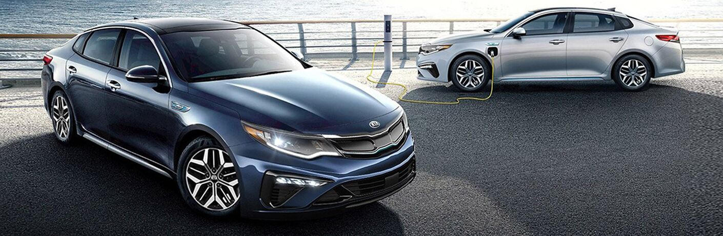 two 2020 Kia Optima Hybrid models parked next to each other