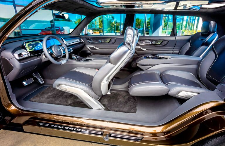 2020 Kia Telluride interior wide shot of cabin space including seating upholstery design and dashboard layout