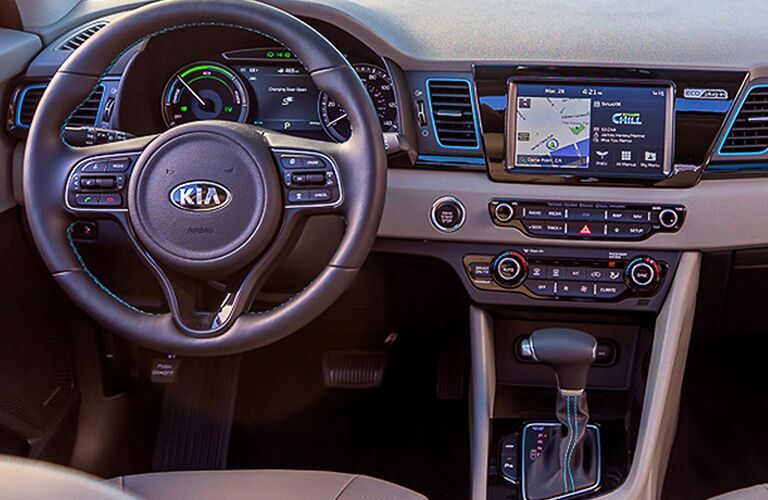 2018 Kia Niro Plug-In Hybrid interior view of steering wheel, transmission, and dashboard screen