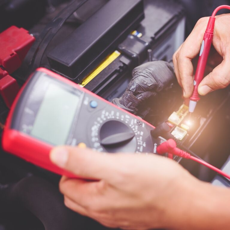 Tech checking a car battery