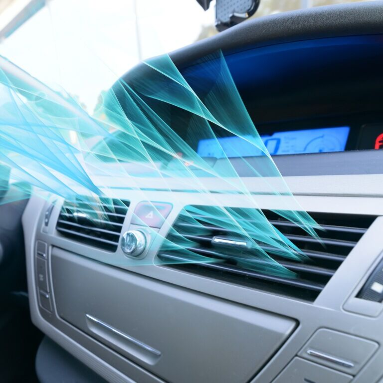 car vents with blue stylized air