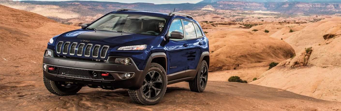 2018 Jeep Cherokee exterior blue front in desert
