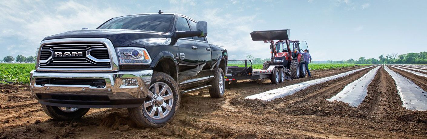 2018 Ram 2500 hauling farming equipment out in the field