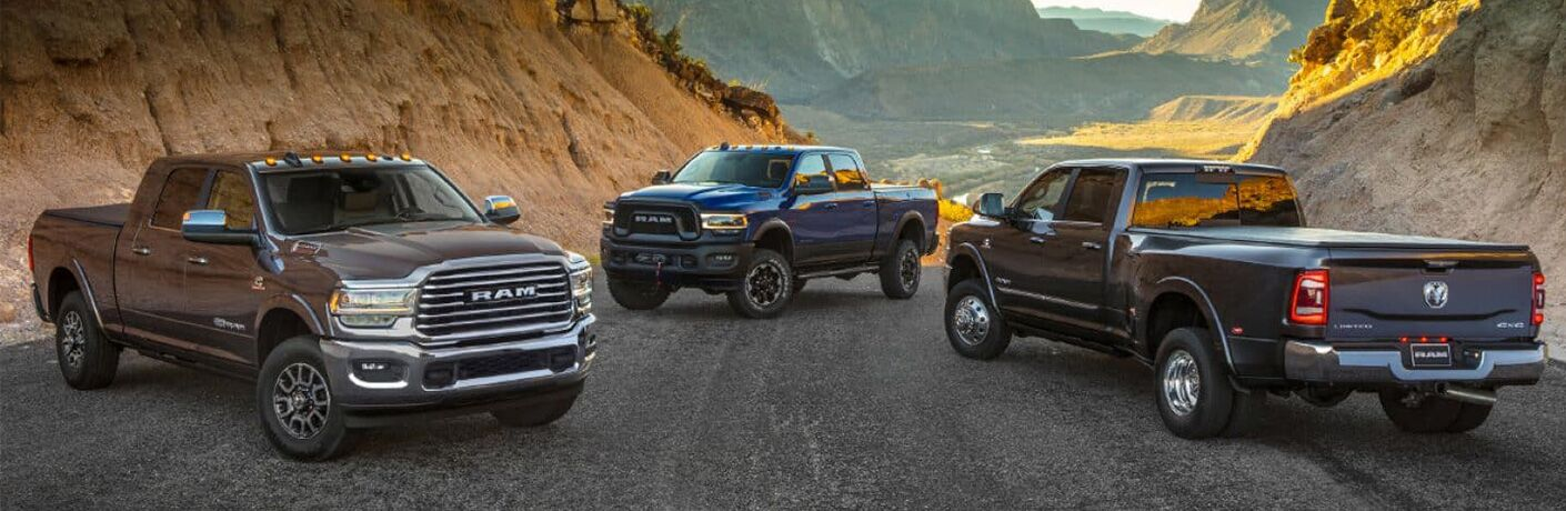 2019 RAM Heavy Duty trucks lined up on a valley road